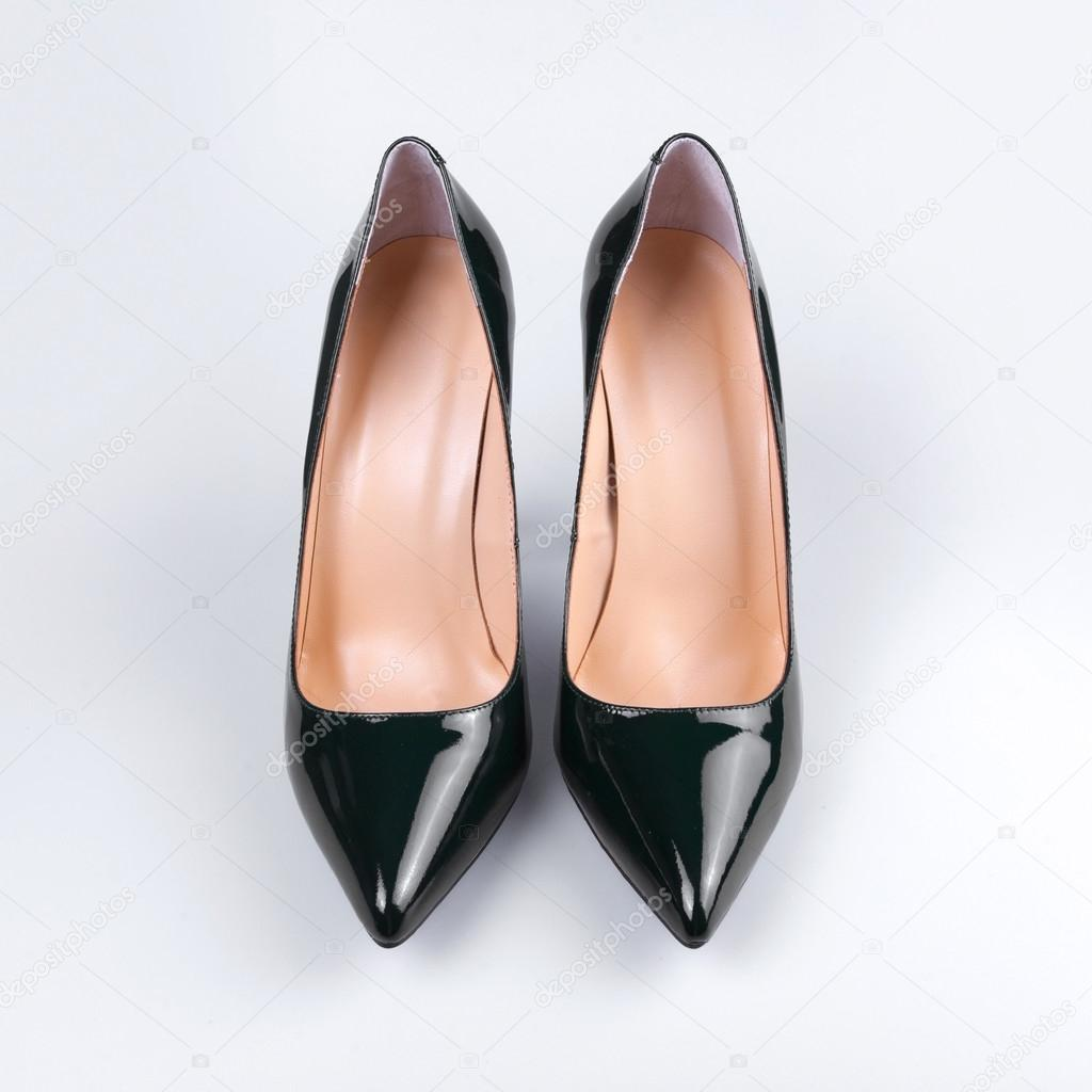 47d12b6baa8c Elegant expensive black high heel women shoes on white background — Photo  by ...