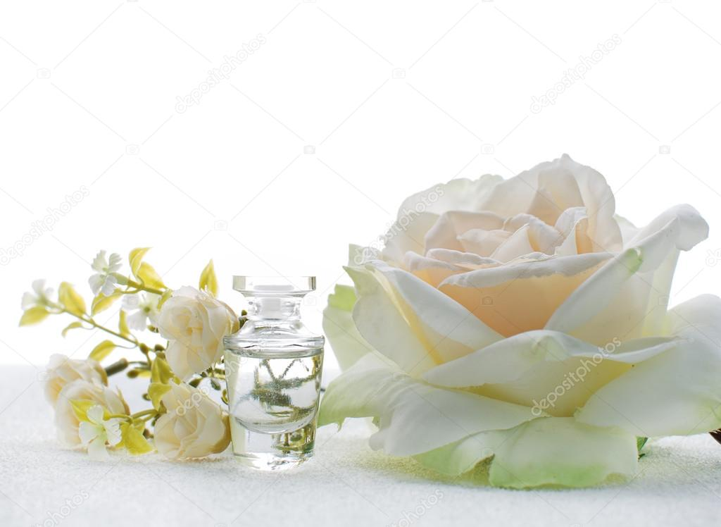Small bottle of perfume with white flowers stock photo small bottle of perfume with white flowers stock photo mightylinksfo
