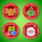 Photo Set of vector Christmas stickers. Cookies, mistletoe, gifts, and