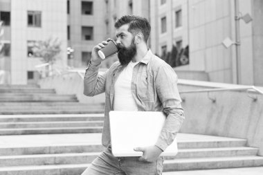Coffee break. Guy going to work urban background. Man with laptop walking empty street. Business life. Modern life. Hipster modern worker with notebook. Modern technology. Social distancing era