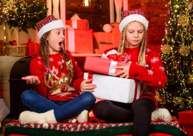 Bring up generosity. Christmas gifts concept. Sisterhood. Girls friends celebrate christmas. Boxing day. Happy holidays. Fun and cheer. Children cheerful christmas eve. Sharing gifts. Sharing ability