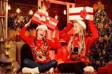 Fun and cheer. Children cheerful christmas eve. Sharing gifts. Sharing ability. Bring up generosity. Christmas gifts concept. Sisterhood. Girls friends celebrate christmas. Boxing day. Happy holidays