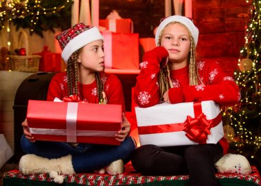 Sharing ability. Bring up generosity. Christmas gifts concept. Sisterhood. Girls friends celebrate christmas. Boxing day. Happy holidays. Fun and cheer. Children cheerful christmas eve. Sharing gifts