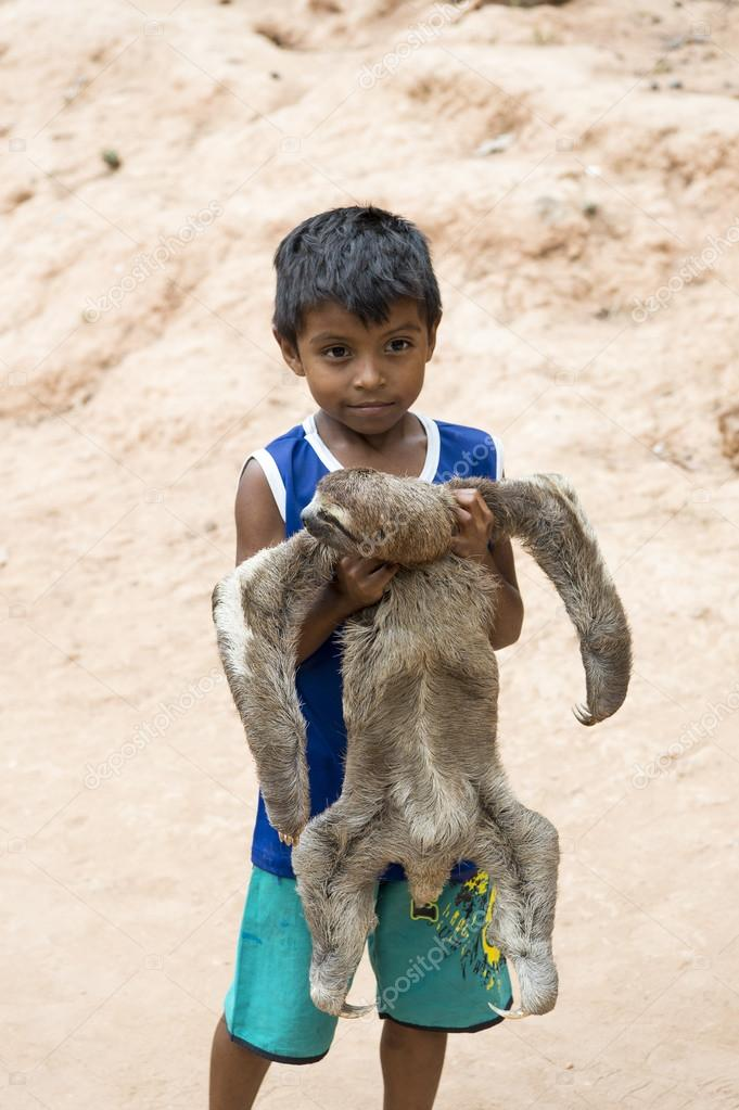 Boy holding sloth