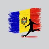 Fotografia Azione del giocatore di calcio con la bandierina della Repubblica di Moldova su backgroun