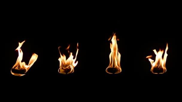 Skutečný oheň izolovaných na černém pozadí. zpomalující rychlost zpomalit 0,25 x.