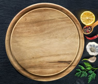 Wooden cutting board and spices