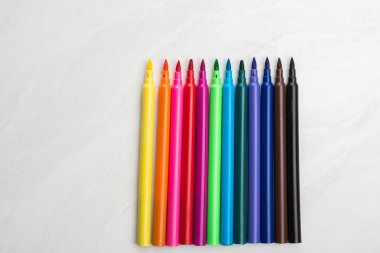 Colorful markers on table