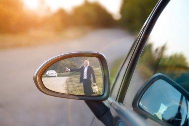 young Hitchhiking man