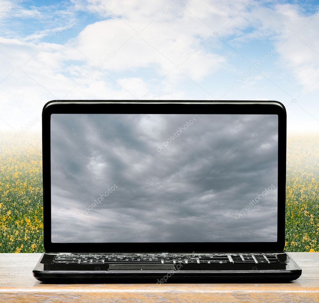 weather in  world and  clouds on laptop