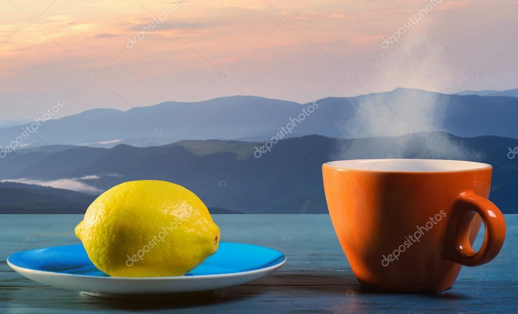Tea with lemon and mountains