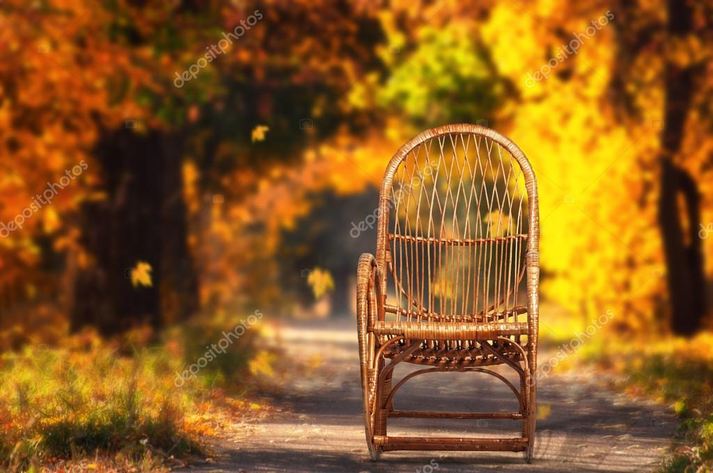 Rocking chair in  autumn garden