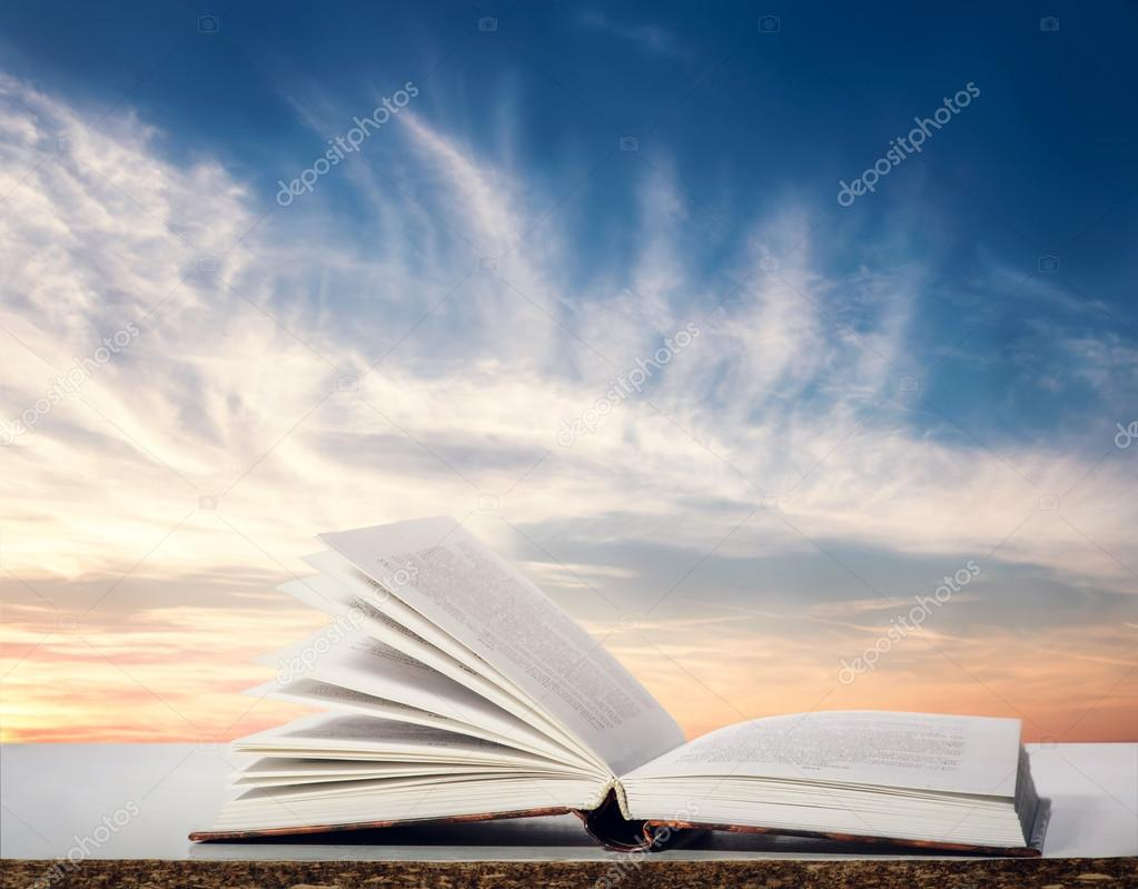 Open book on natural background