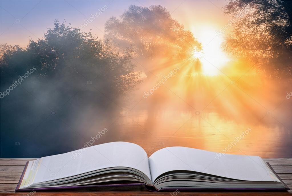 Open book against sunrise