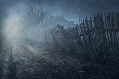 Dark mysterious street (focus on fence) stock vector
