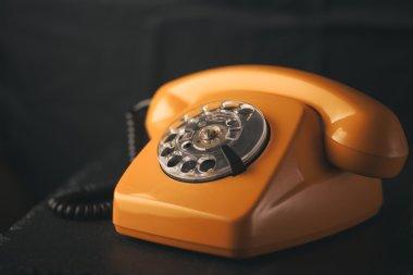 Retro phone on black