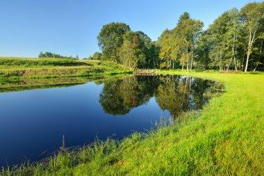Calm countryside lake