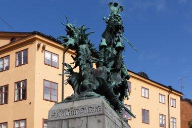Sweden. Stockholm. Sculpture of St. George the Victorious striking sword dragon.