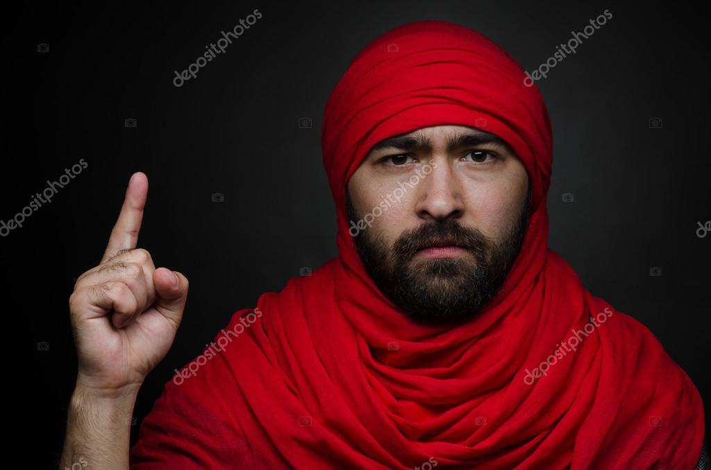 Turkish And Arabic Theme Beautiful Arabic Man With A Beard In A Red Scarf Showing