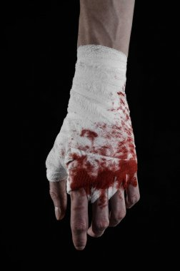 Shook his bloody hand in a bandage, bloody bandage, fight club, street fight, violence, bloody theme, isolated, bloody fists, boxer, tied his hands with a bandage, black background