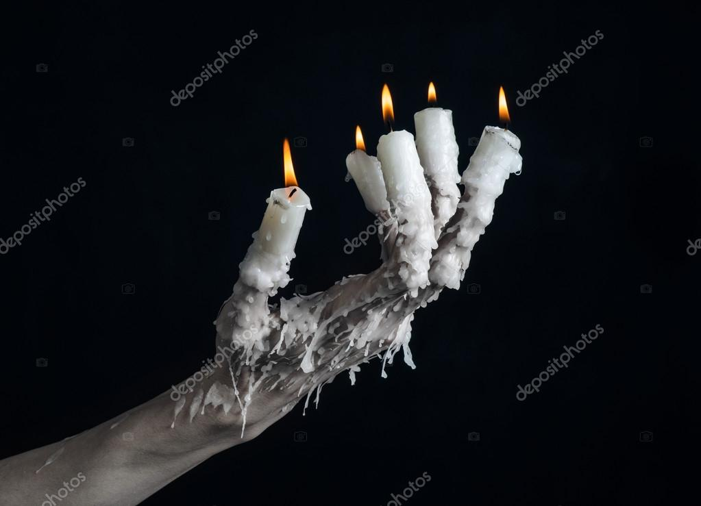 Halloween Theme On The Hand Wearing A Candle And Dripping Melted