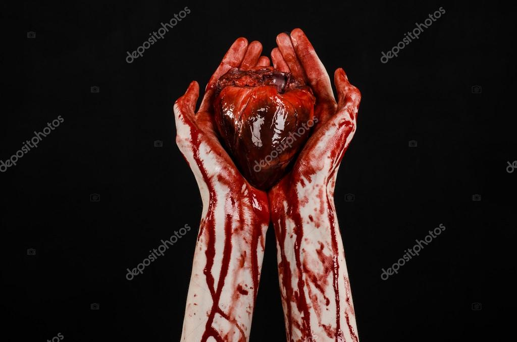 blood and halloween theme terrible bloody hand hold torn bleeding human heart isolated on black - Blood For Halloween