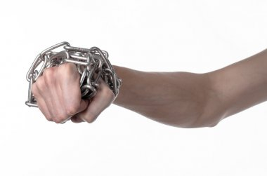 Social theme: hands tied a metal chain on a white background