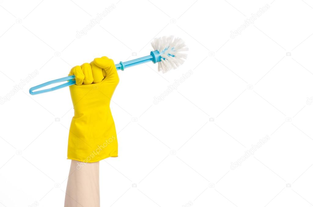 Cleaning the house and cleaning the toilet  human hand holding a blue  toilet brush in yellow protective gloves isolated on a white background —  Foto de ... b430a49bc6a9