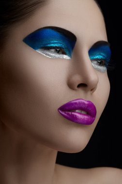 Purple lips, blue shadows on the eyes, black eyebrows Women Makeup Beauty
