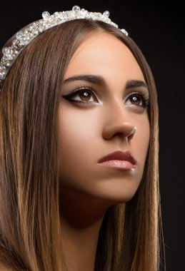 Beautiful girl with a crown on his head, a portrait of a beautiful girl, studio, evening makeup, princess, queen, glamorous young girl, dreamy girl, black background