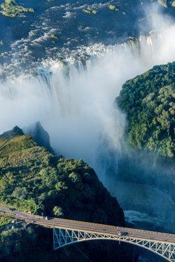 Victoria Falls bridge with falls in background