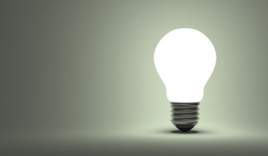 Shining arbitrary light bulb on gray