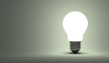 Shining arbitrary light bulb on gray