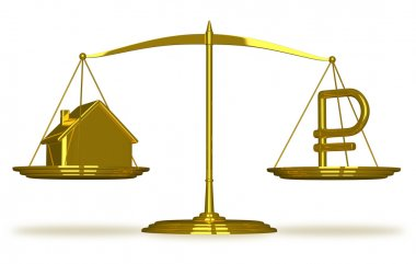 Golden house and ruble sign on scales