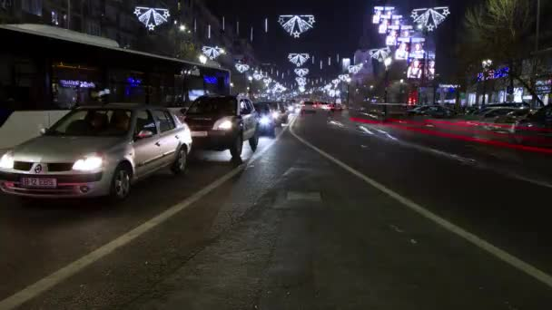 Traffic jam on I.C. Bratianu Boulevard. The boulevard is decorated with christmas decorations. Time lapse shot.