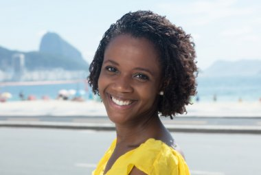 Beautiful african american woman in a yellow shirt at Rio de Jan