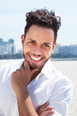 Laughing brazilian man with skyline in the background