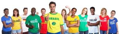 Brazilian sports fan showing thumb with 10 international fans