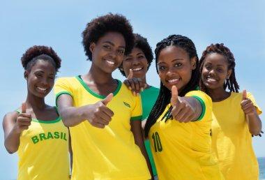 Group of brazilian fans at Copacabana beach at Rio de Janeiro