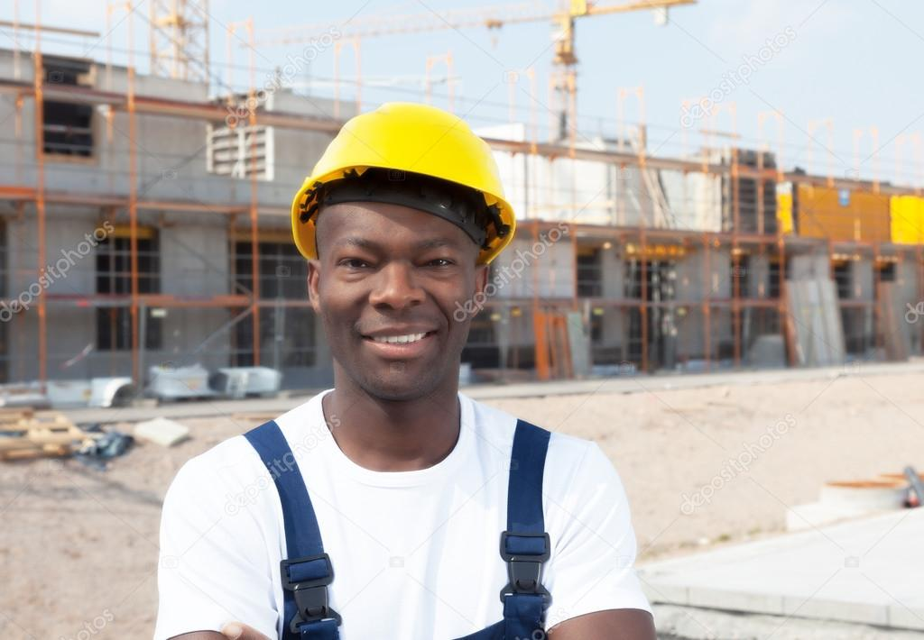 Laughing african american construction worker at building site