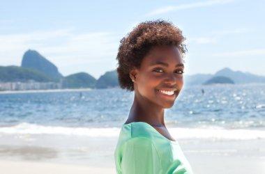 Happy brazilian woman at Copacabana beach