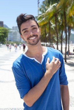 Dreaming brazilian guy in a modern city