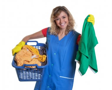 Laughing blonde housewife with dirty clothes