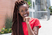 Beautiful african woman with dreadlocks in the city