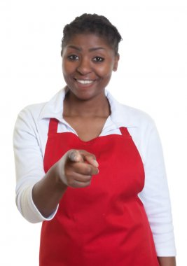 Laughing african american waitress pointing at camera