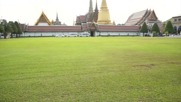 Wat Phra Kaew, Grand palace, Temple of the Emerald Buddha with sky and green lawn. Landmark of Bangkok,Thailand