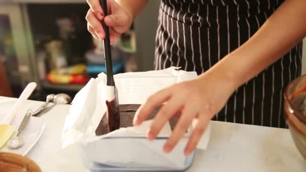 Making Chocolate Brownie Cake. Pouring and grating Melting Chocolate surface before bake