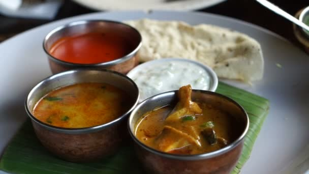 Indian curries different color and nan bread serve in restaurant