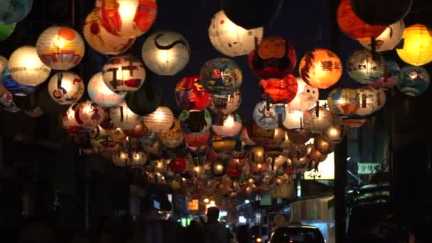 Taiwanese lantern festival. Children hand painted lanterns hanging over night walking street