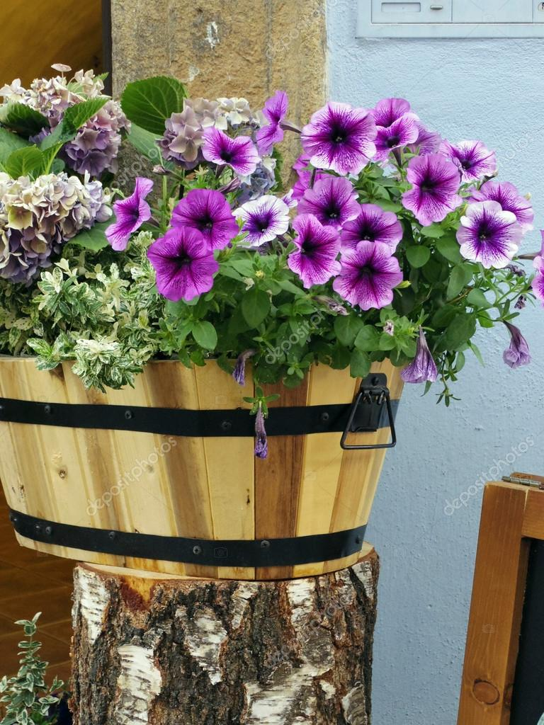 flowers in wood bucket